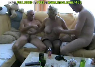 blonde granny in stockings has a three-some with